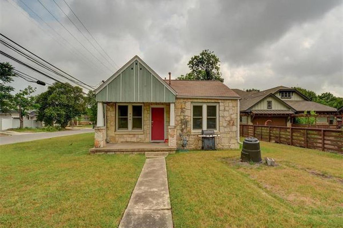 Small 1941 stone cottage on corner lot that's kind of bare in front