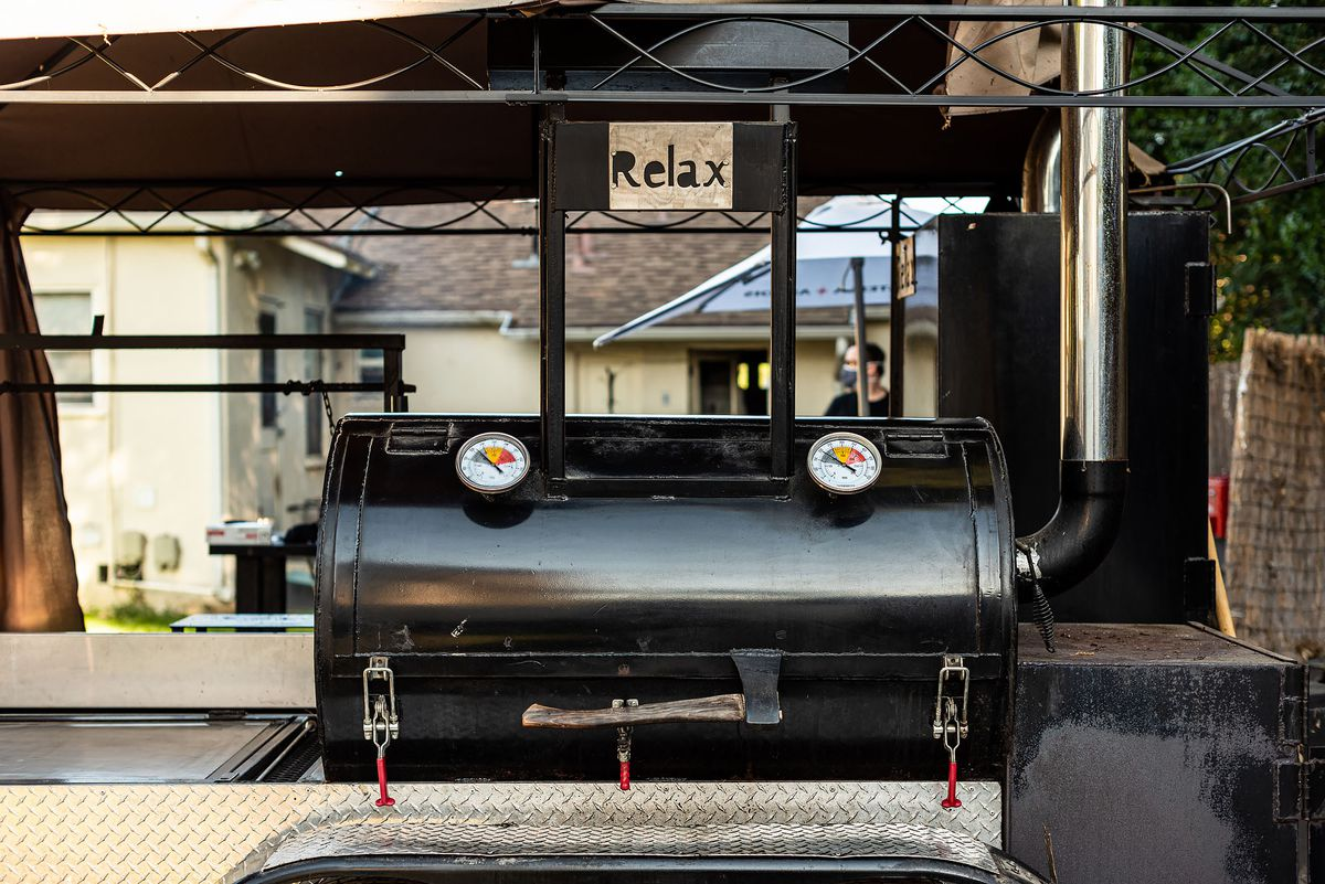 A closed smoker has a sign above it that reads 'relax.'