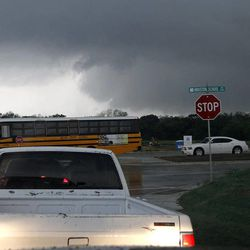 Threatening clouds continue to move through southern Tarrant and Dallas counties after a tornado swept through Lancaster, Texas on Tuesday, April 3, 2012. Tornadoes tore through the Dallas area Tuesday, peeling roofs off homes, tossing big-rig trucks into the air and leaving flattened tractor trailers strewn along highways and parking lots.