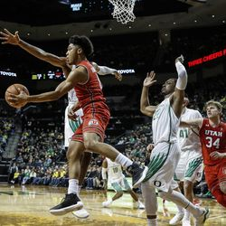 Utah guard Sedrick Barefield (0) passes the ball off during the team's NCAA college basketball game against Utah on Friday, Dec. 29, 2017, in Eugene, Ore. (AP Photo/Thomas Boyd)