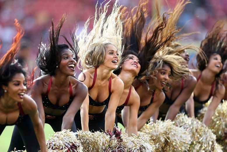 LANDOVER, MD - AUGUST 27: Washington Redskins cheerleaders dance during a stoppage in play as the Washington Redskins play the Cincinnati Bengals in the second half during a preseason game at FedExField on August 27, 2017 in Landover, Maryland. (Photo by Patrick Smith/Getty Images)