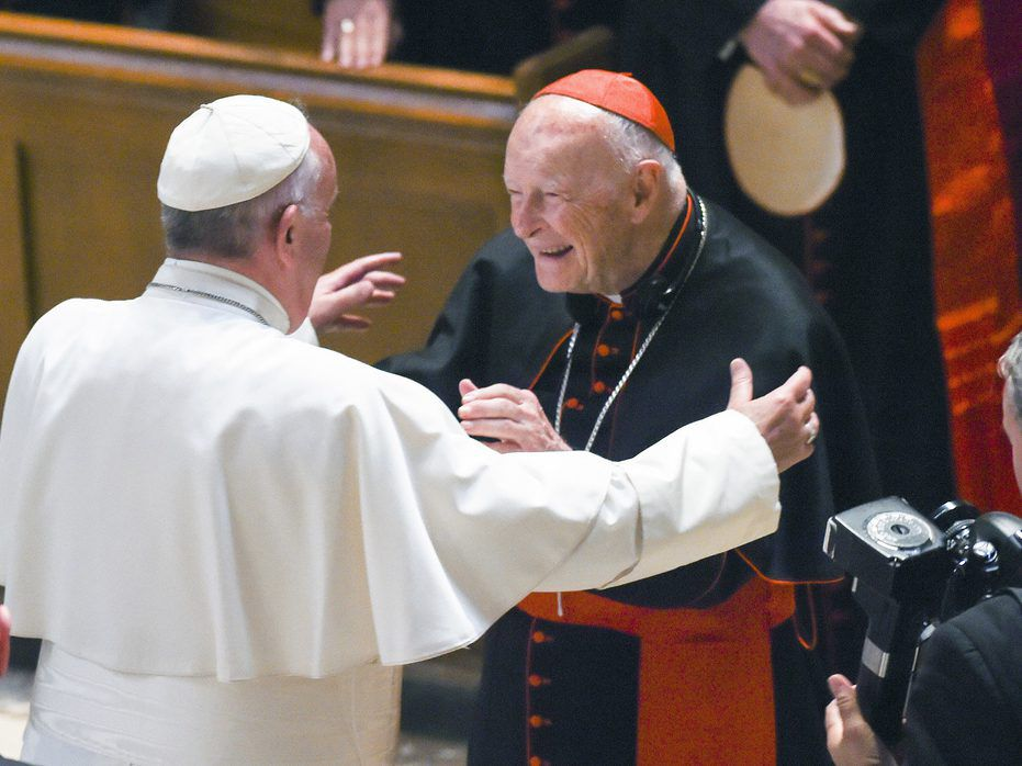 Pope Francis reaches out to hug Cardinal Archbishop emeritus Theodore McCarrick at the Cathedral of St. Matthew the Apostle in Washington in 2015. (Jonathan Newton/The Washington Post via AP)