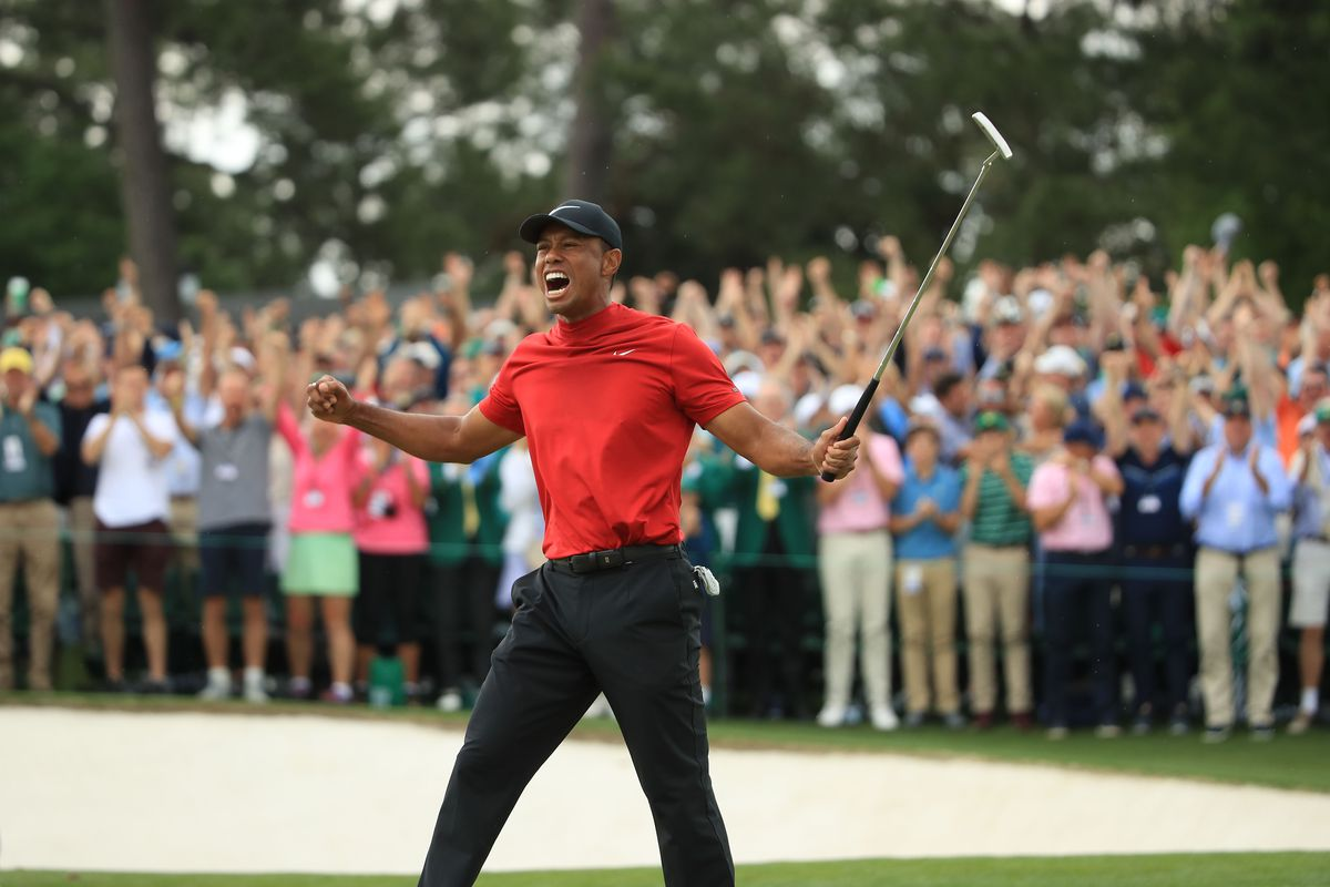Tiger Woods (L) of the United States celebrates on the 18th green after winning the Masters at Augusta National Golf Club on April 14, 2019 in Augusta, Georgia.