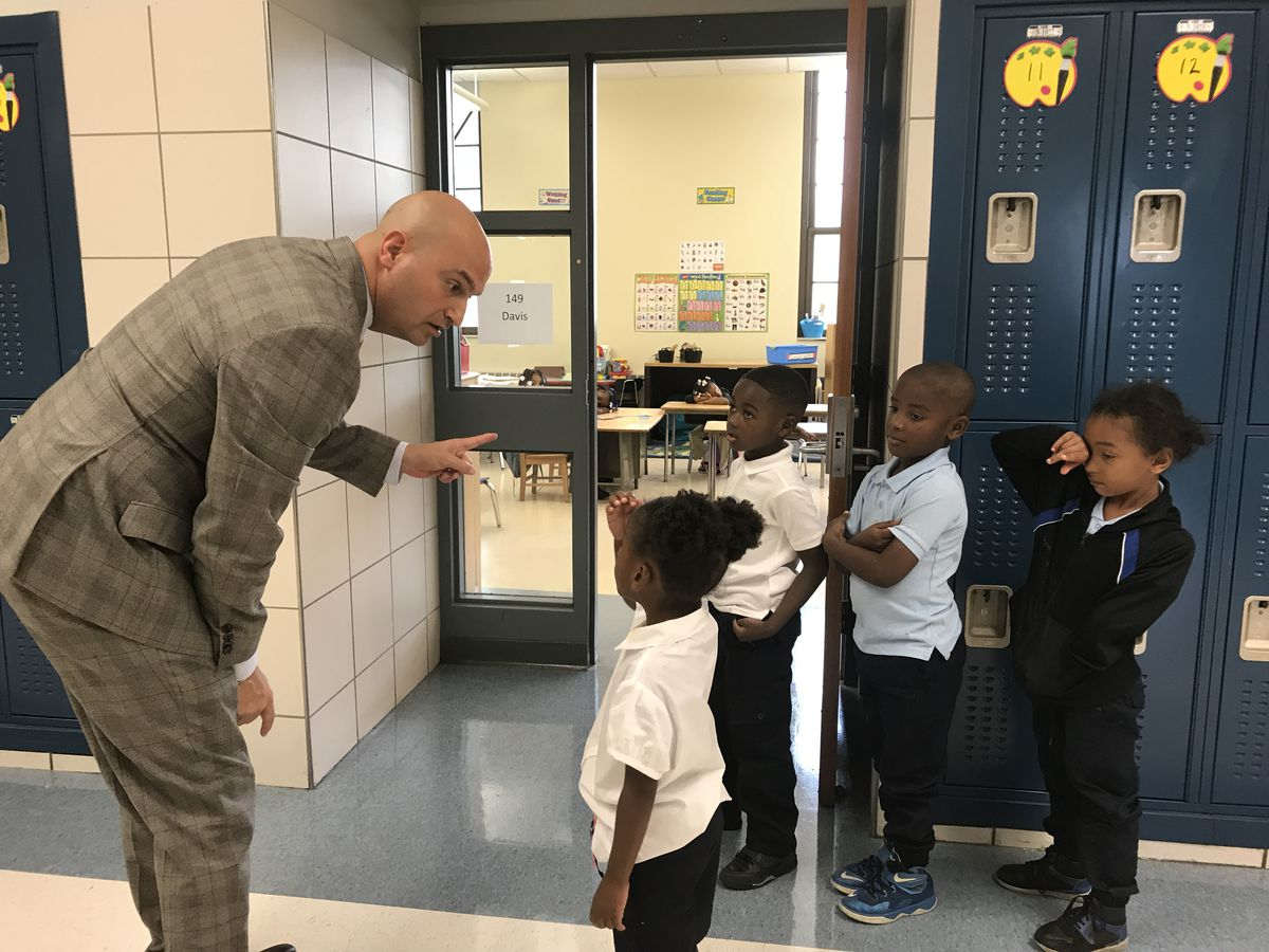 Detroit supertintendent Nikolai Vitti talks with students at Durfee Elementary/Middle School on the first day of school, September 5, 2017.