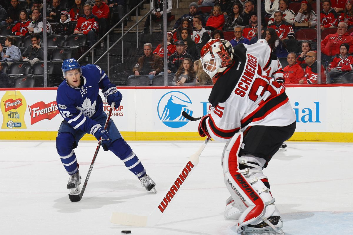 Connor Brown #12 of the Toronto Maple Leafs moves in on Cory Schneider #35 of the New Jersey Devils and eventually scores a shorthanded goal at 13:17 of the first period at the Prudential Center on January 6, 2017 in Newark, New Jersey.