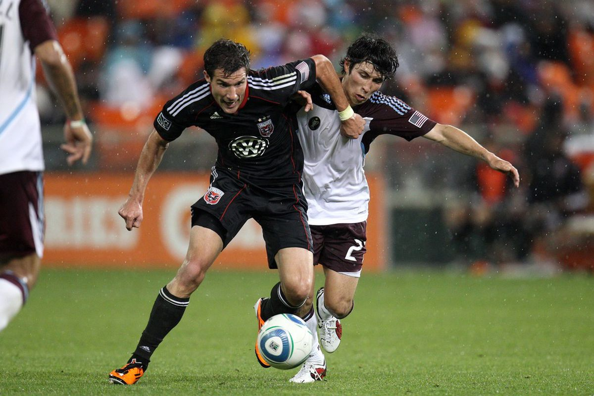 WASHINGTON, DC - MAY 14: Chris Pontius #13 of D.C. United controls the ball against Kosuke Kimura #27 of the Colorado Rapids at RFK Stadium on May 14, 2011 in Washington, DC. (Photo by Ned Dishman/Getty Images)