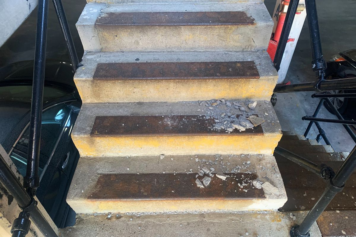 A staircase was littered with debris inside a parking garage at East 153rd Street near Yankee Stadium, Dec. 3. 2020.