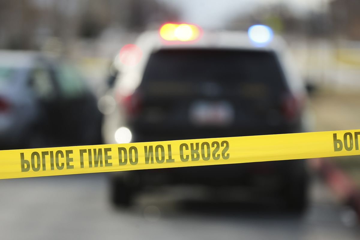 Members of the Davis County Sheriff's Office and the Farmington Police Department investigate an officer-involved fatal shooting in Farmington on Sunday, Dec. 13, 2020. police tape, dnstock, crime scene, police line