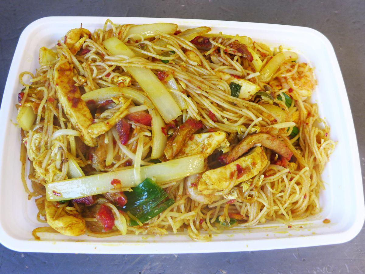 Thin yellowish noodles stir fried.