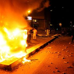 A vehicle burns during clashes outside the U.S. embassy in Cairo, Egypt, early Thursday, Sept. 13, 2012, as part of widespread anger across the Muslim world about a film ridiculing Islam's Prophet Muhammad.