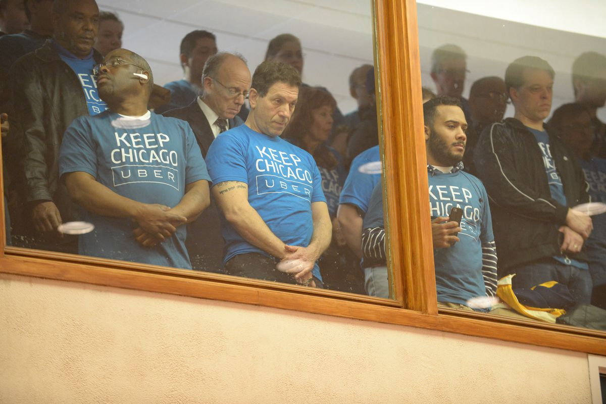 Supporters of the ride-hailing service Uber observed Wednesday's Chicago City Council meeting from the balcony. | Brian Jackson/ For the Sun-Times
