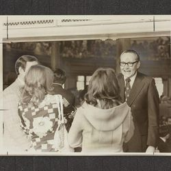 Elder L. Tom Perry welcomes young people as they enter the Tabernacle in April 1976.