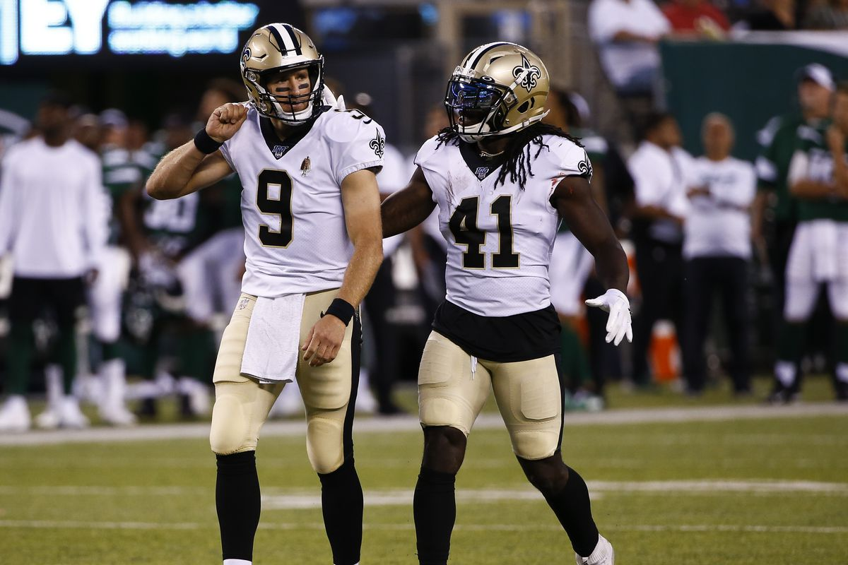 Quarterback Drew Brees and running back Alvin Kamara of the New Orleans Saints celebrate a touchdown against the New York Jets during a pre-season game at MetLife Stadium on August 24, 2019 in East Rutherford, New Jersey.