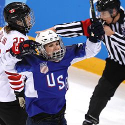 Monique Lamoureux-Morando #7 of the United States celebrates after scoring a goal against Canada in the third period.