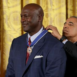 President Barack Obama awards the Presidential Medal of Freedom to National Basketball Association Hall of Fame member and legendary athlete Michael Jordan during a ceremony in the East Room of the White House November 22, 2016 in Washington, DC.(Photo by Chip Somodevilla/Getty Images)