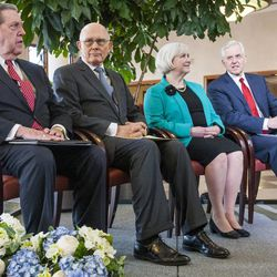 Elder Jeffrey R. Holland, Elder Dallin H. Oaks, Sister Neill F. Marriott and Elder D. Todd Christofferson attend a news conference inside the Conference Center in Salt Lake City to reemphasize support for LGBT nondiscrimination laws that protect religious freedoms.