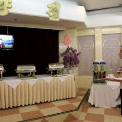 A North Korean waitress watches a North Korean TV news program acknowledging the country's failed rocket launch at a hotel restaurant in Pyongyang, North Korea, Friday, April 13, 2012. The much-anticipated rocket launch ended quickly in failure early Friday, splintering into pieces over the Yellow Sea soon after takeoff.