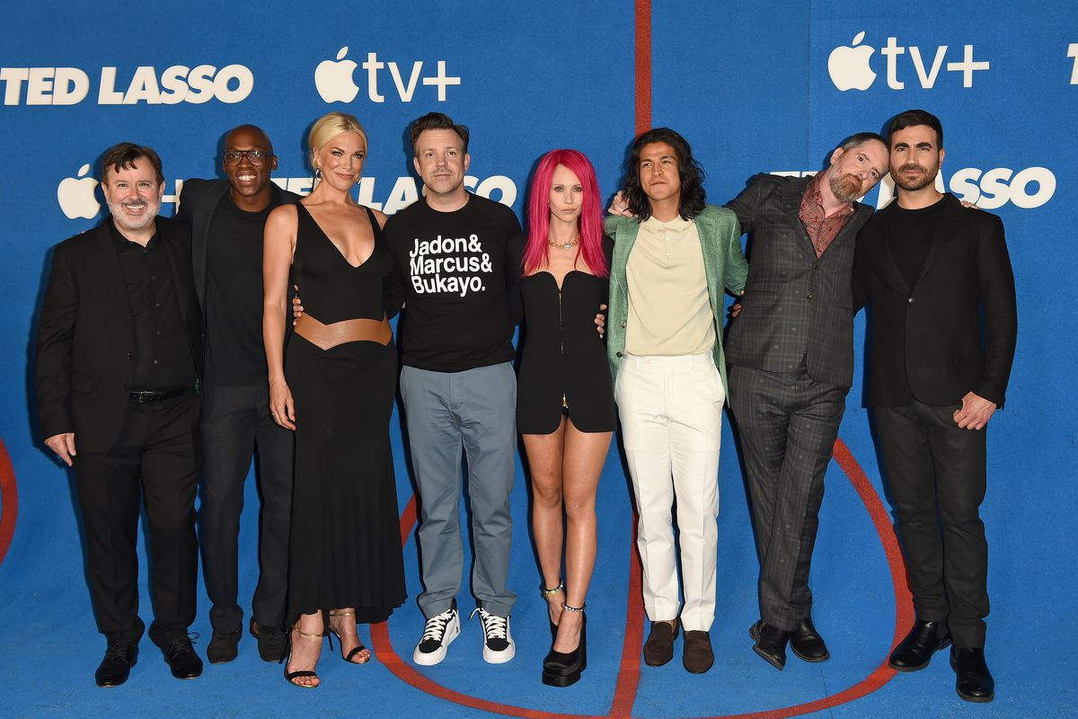 """Jeremy Swift, Moe Jeudy-Lamour, Hannah Waddingham, Jason Sudeikis, Juno Temple, Cristo Fernández, Brendan Hunt, and Brett Goldstein attend Apple's """"Ted Lasso"""" Season 2 Premiere at Pacific Design Center on July 15, 2021 in West Hollywood, California."""
