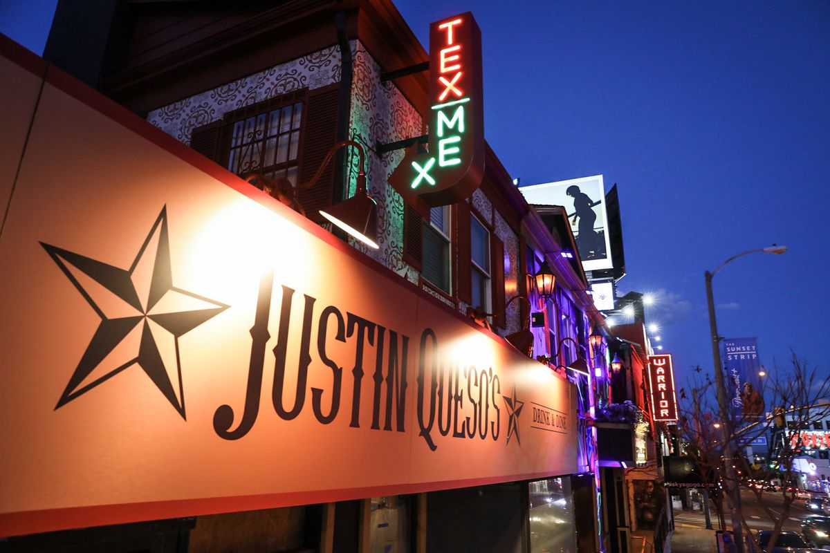 A well-lit sign, shown from the sky, showing a Tex-Mex restaurant, complete with neon glow.