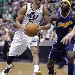 Utah Jazz guard Devin Harris (5) drives into the lane around Denver Nuggets guard Ty Lawson (3) as the Utah Jazz and the Denver Nuggets play Friday, March 23, 2012.