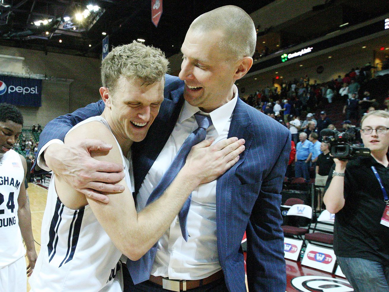 Brigham Young Cougars guard Tyler Haws (3) celebrates the win over Santa Clara Broncos with assistant coach Mark Pope during the West Coast Conference Basketball Championships in Las Vegas Saturday, March 7, 2015. BYU won 78-76.