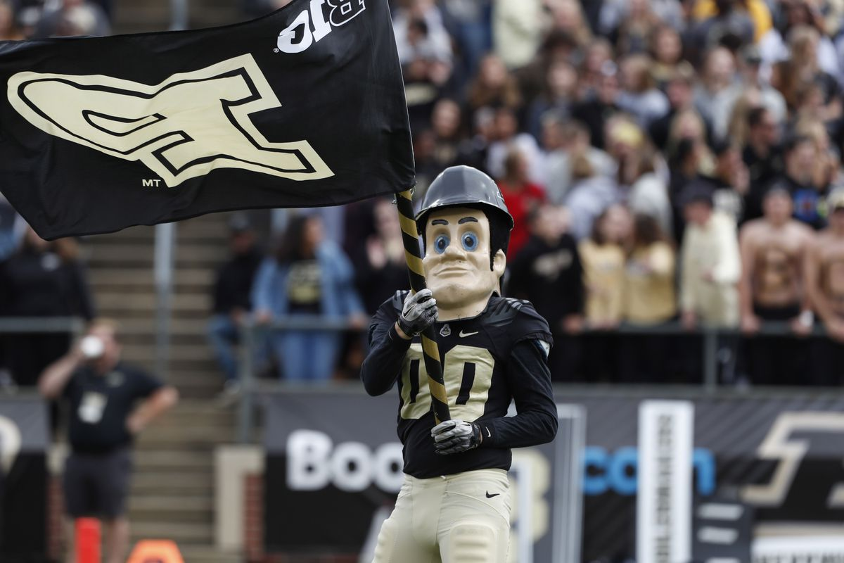 Purdue Boilermakers mascot Purdue Pete waves a Purdue flag in a game against the Boston College Eagles during the first quarter at Ross-Ade Stadium.