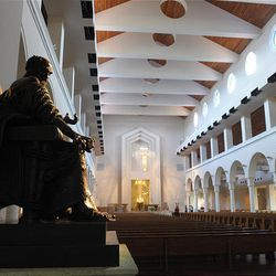 A statue of Saint Peter sits at the entrance to the sanctuary of the National Shrine of Mary, Queen of the Universe, in Orlando, Fla.