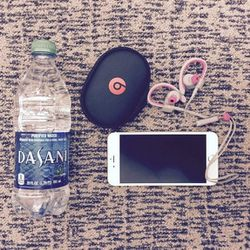 My flight essentials consist of new Beats by Dre Powerbeats2 wireless headphones and a bottle of water. Couldn't survive a five-hour flight without either of the two.