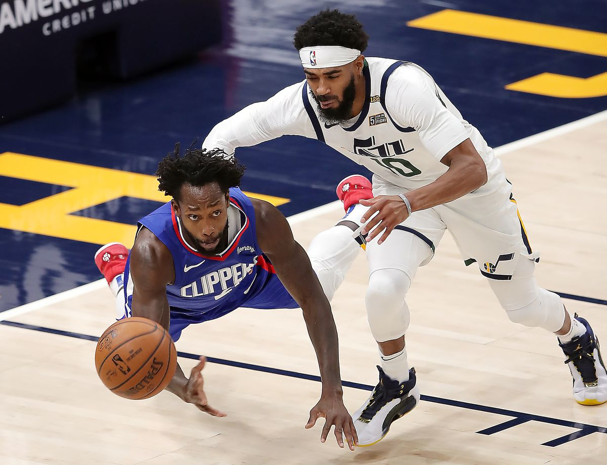 LA Clippers guard Patrick Beverley (21) and Utah Jazz guard Mike Conley (10) chase down the ball