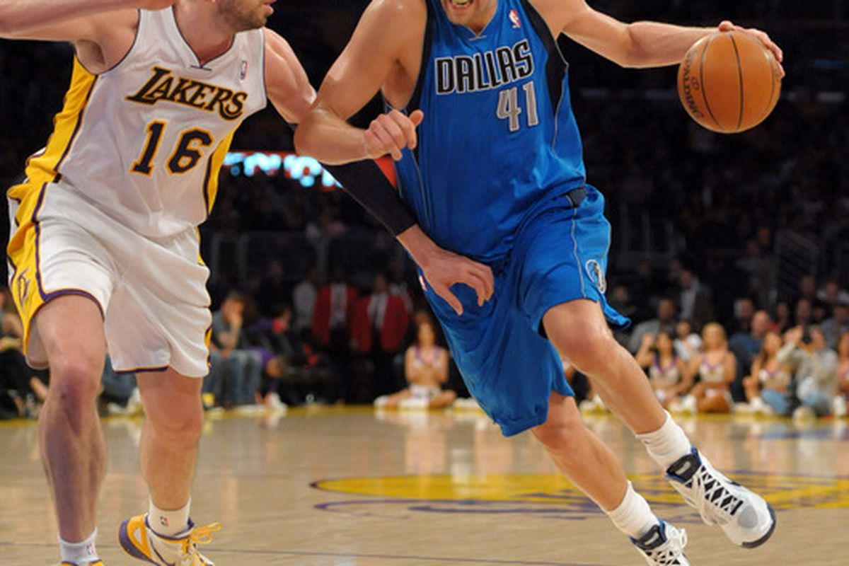 Apr 15, 2012; Los Angeles, CA, USA; Dallas Mavericks forward Dirk Nowitzki (41) is defended by Los Angeles Lakers forward Pau Gasol (16) at the Staples Center. Mandatory Credit: Kirby Lee/Image of Sport-US PRESSWIRE