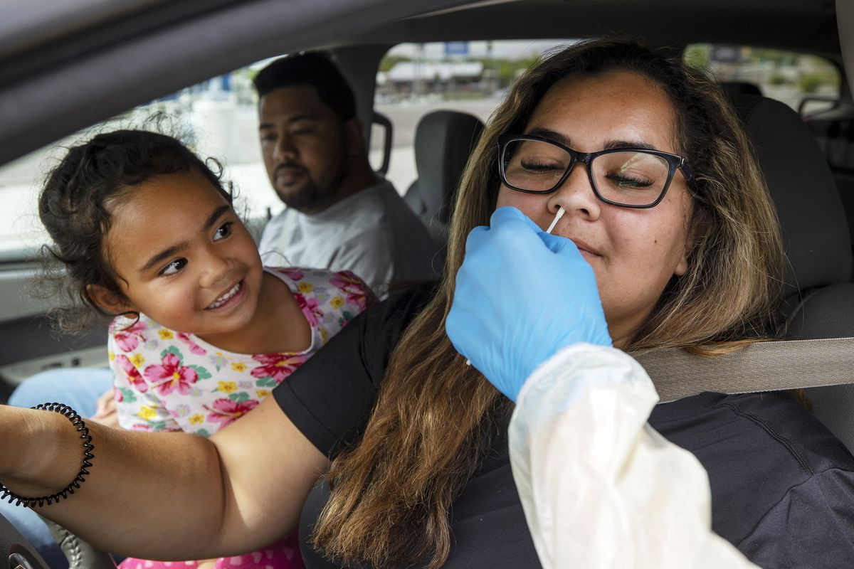 Tialani Alatini, watches as her mom Justina Alatini, receives a Rapid Antigen COVID-19 test at Rio Tinto Stadium in Sandy on Monday, Aug. 2, 2021.