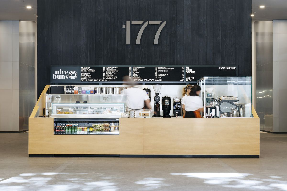 A small cafe takeaway inside the lobby of a new building.