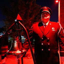 Firefighter David Bradley rings a bell to honor fallen firefighters during the Light the Night ceremony at Unified Fire Station 124 in Riverton on Monday, Sept. 28, 2020.