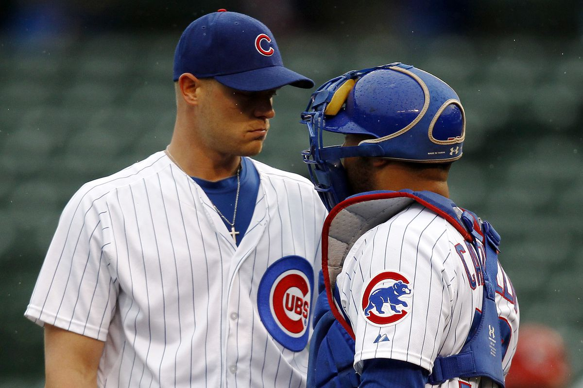 Michael Bowden, talking with ex-Cubs catcher Welington Castillo, pitched for the Cubs in 2012 and 2013.