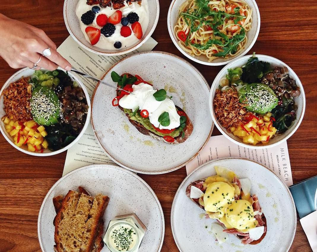 Avocado toast, poke bowls and granola with yoghurt at all-day dining restaurant Milk Beach in Queen's Park, north west London