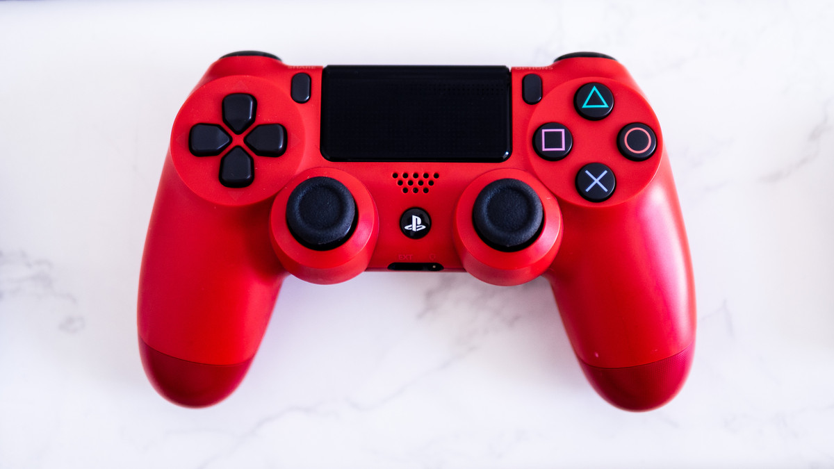 Redy Sony Playstation Dualshock controller laid flat on a marble table top.