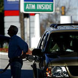 Ed Jansen of St. Louis buys gas Wednesday for $2.08.9. Oil executives sought to justify their huge profits under tough questioning Wednesday, but they found little sympathy from senators who said their constituents are suffering from high energy prices.