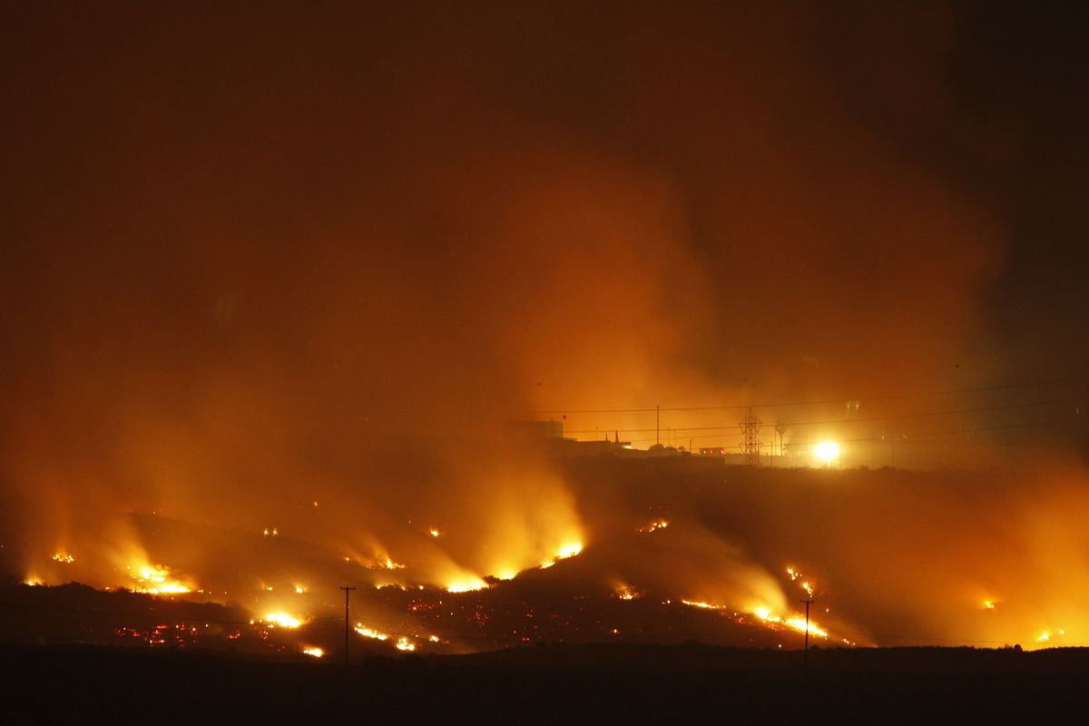 The Las Pulgas Fire lights the night on May 16, 2014 at Camp Pendleton, California. The fire is one of three large wildfires on Camp Pendleton that have scorched more than 22,000 acres.