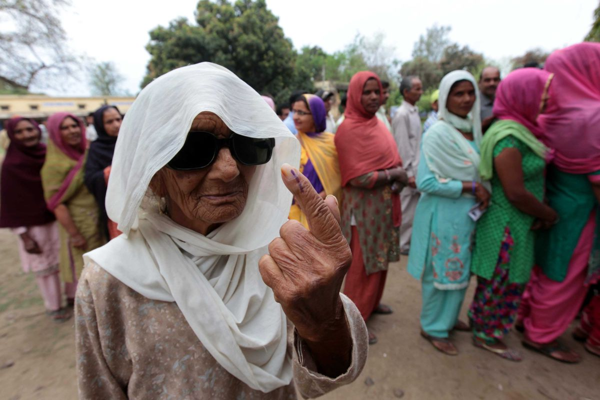 This woman just voted in the 2014 Indian elections, the largest in human history. Like a boss.