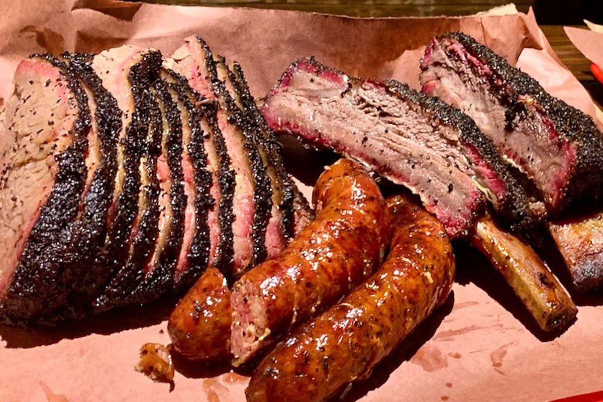 Smoked brisket, sausage, and ribs from Queue
