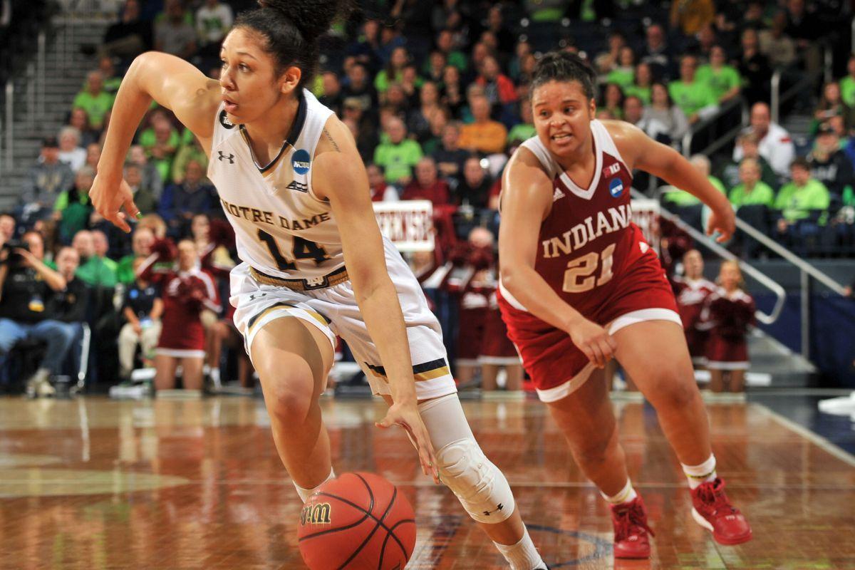 Karlee McBride (right) chases Notre Dame's Mychal Johnson.