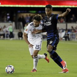 Real Salt Lake midfielder Danilo Acosta (25) is defended by San Jose Earthquakes forward Danny Hoesen (9) during the second half of an MLS soccer match Saturday, June 24, 2017, in San Jose, Calif. (AP Photo/Marcio Jose Sanchez)