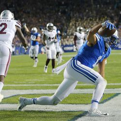Brigham Young Cougars wide receiver Moroni Laulu-Pututau (1) spikes the ball on the field for a personal foul penalty after making a reception for a touchdown as BYU and Mississippi State play in Provo at LaVell Edwards Stadium on Friday, Oct. 14, 2016.