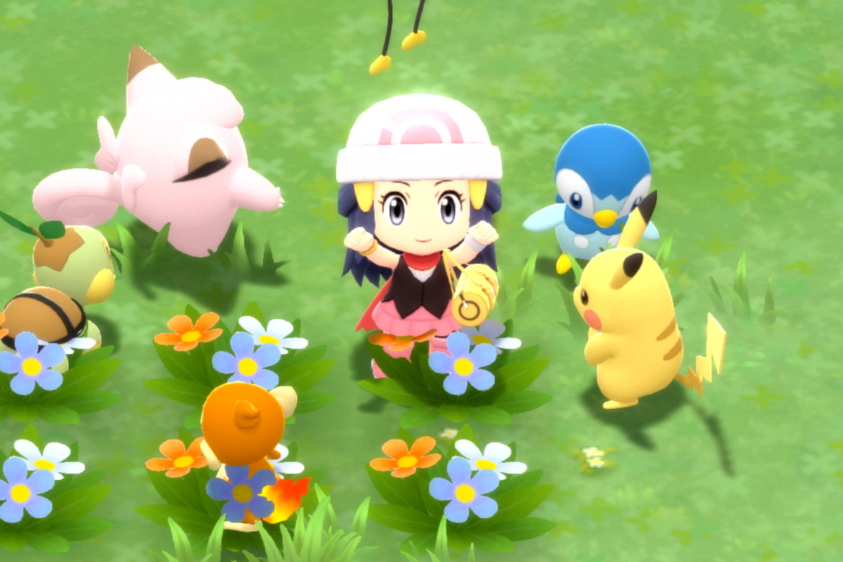 The main character from sitting alongside Pikachu and friends in a flower patch in Pokémon Brilliant Diamond and Pokémon Shining Pearl