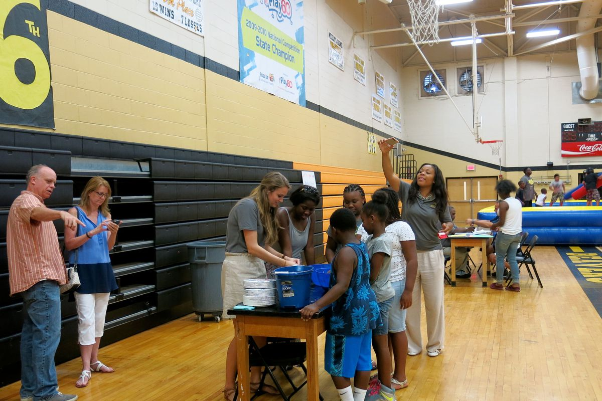 Teachers at Neely's Bend College Prep School help incoming fifth-graders make slime at the new Nashville charter school's open house in August. Teachers from Neely's Bend Middle School, which is being phased out, were also on hand to help.