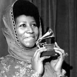 """Aretha Franklin poses with her Grammy Award for best female R&B vocal performance for """"Ain't Nothing Like the Real Thing."""" 