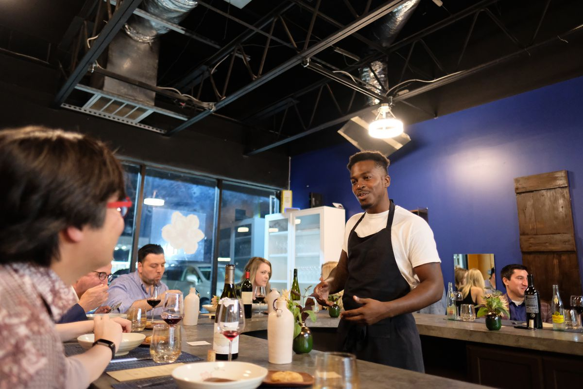 Chef Jonny Rhodes serves diners at Indigo