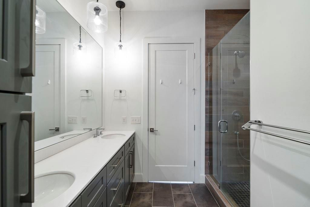 A large bathroom space with sinks at left.