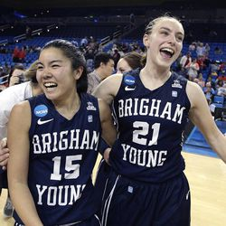 BYU's Kylie Maeda (15) and Lexi Eaton (21) celebrate the team's 80-76 win against Nebraska in a second-round game of the NCAA women's college basketball tournament on Monday, March 24, 2014, in Los Angeles. (AP Photo/Jae C. Hong)