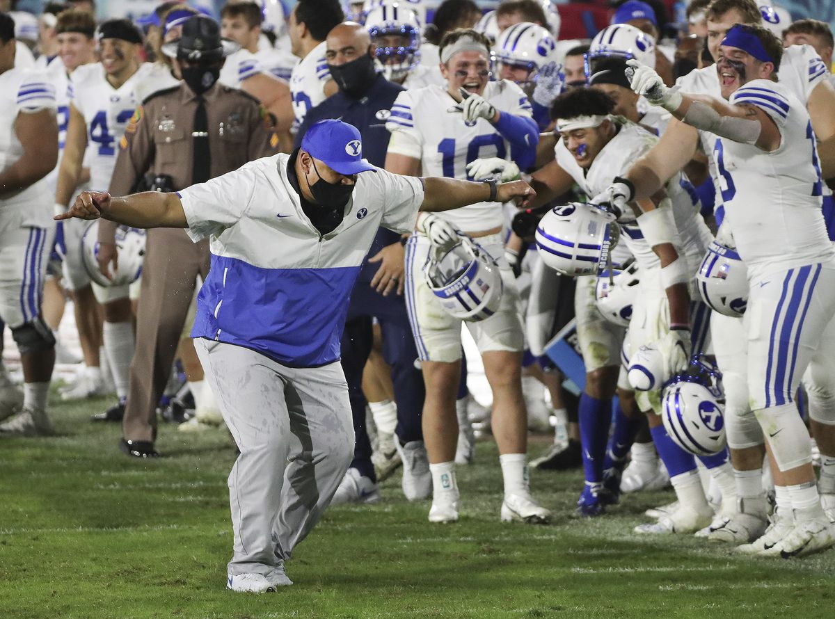 Brigham Young Cougars head coach Kalani Sitake celebrates the win over the UCF Knights during the Boca Raton Bowl in Boca Raton, Fla., on Tuesday, Dec. 22, 2020. BYU won 49-23.